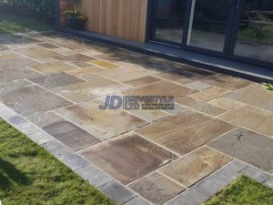 Indian Sandstone Patio with New Grass Lawn in Ashford, Kent