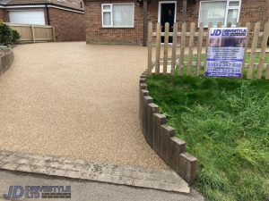 Resin Driveway with Sleeper Wall in Merstham