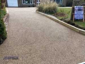 Resin Bound Driveway with Sleeper and Brick Border in Ashford