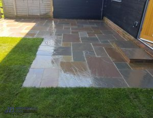 Slabbed Patio with Sleeper Wall and Doorstep in Canterbury