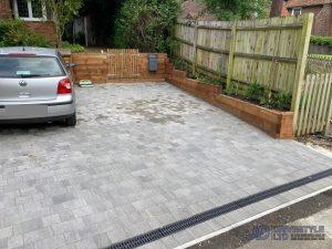 Tegula Paved Driveway with Sleeper Retaining Wall in Ashford, Kent