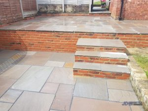 Indian Sandstone Patio with Brick Wall and Steps in Tunbridge Wells