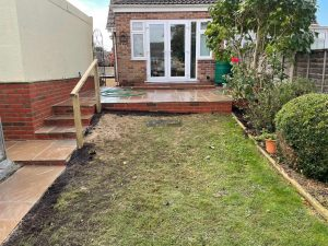 Raised Indian Sandstone Patio with Brick Retaining Wall and Steps in Ashford, Kent